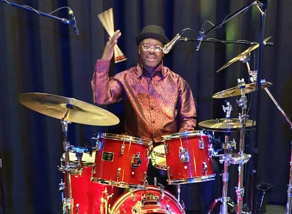 Ghanaian Drummer Jordan performing with 'Opera Pop' duo Dust of Soul